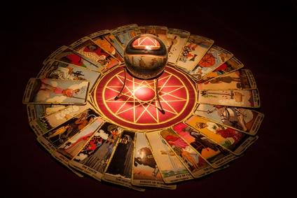 Tarot cards and crystal ball.
